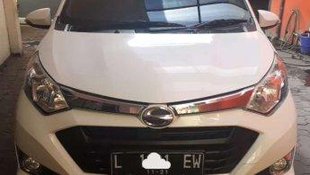 Jual cepat mobil Daihatsu Sigra R 2016 di Jawa Timur